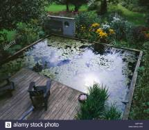 Concrete Sculpture Lily Pond Decking And Adirondack