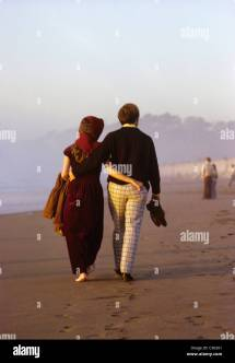 Couple Walking 1960s Stock &