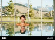 Italy South Tyrol Man In Swimming Pool Of Hotel Urthaler