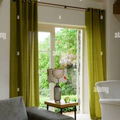 Green Curtains For Living Room Beach Inspired Rooms In Converted Barn With Ceiling Beam And Grey Sofa