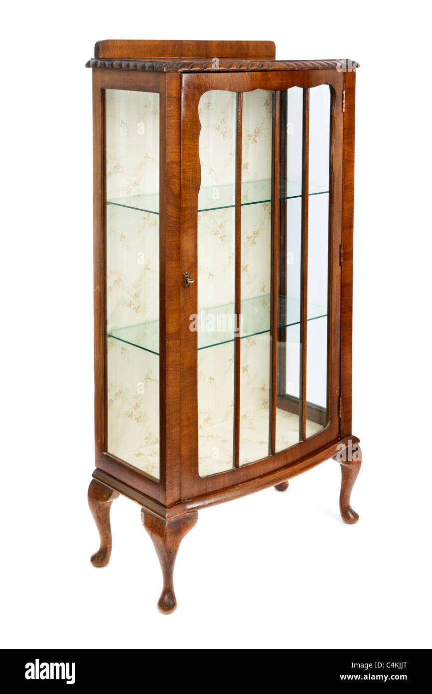 Antique walnut and glass display cabinet Stock Photo