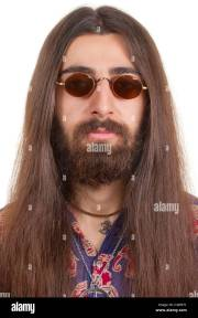 long-haired hippie man in glasses