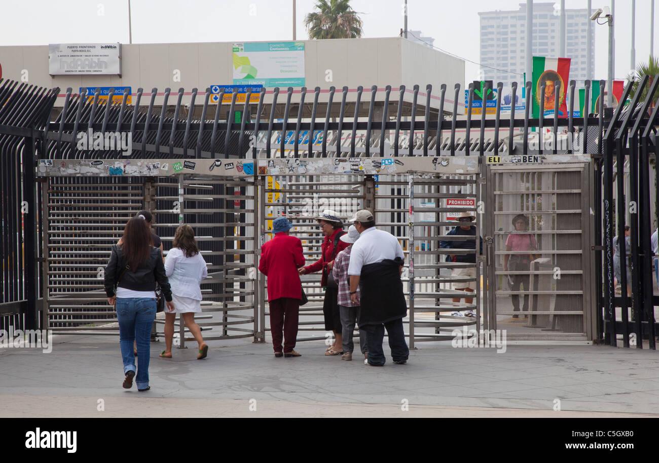 Tijuana Mexico  Pedestrians enter turnstiles as they