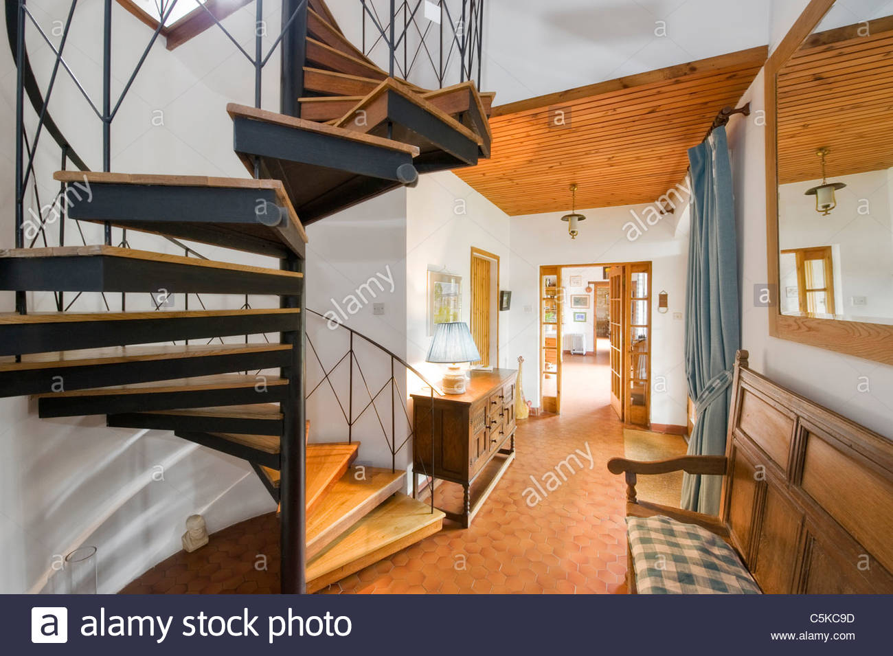 A Renovated Coach House Interior With Spiral Staircase Stock Photo