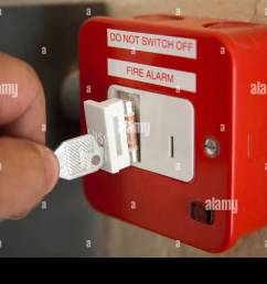 qualified electrician installing fire alarm red fused fixed keyswitch [ 1300 x 956 Pixel ]