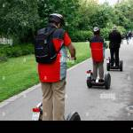 People On 2 Wheeled Stand Up Electric Scooters In A Park Leipzig Stock Photo Alamy
