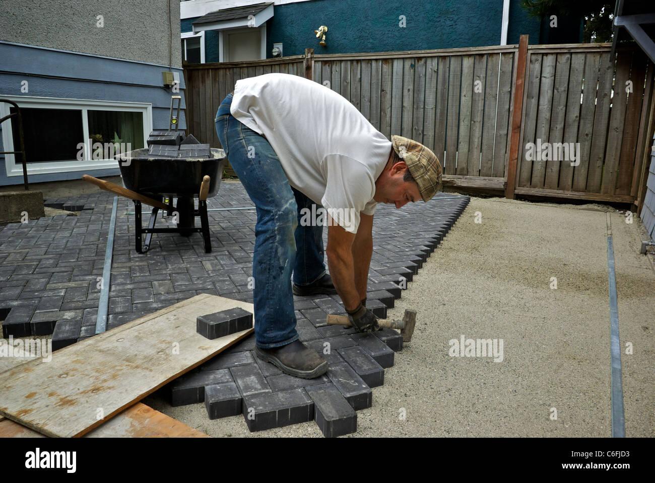 https www alamy com stock photo stonemason laying patio construction bricks sand gravel base backyard 38452431 html