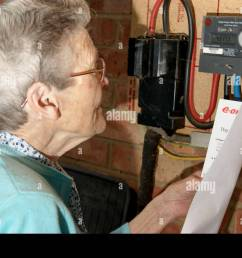 elderly woman looking checking electricity and gas utility bills with the meter in case of discrepancies [ 1300 x 955 Pixel ]