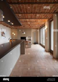 dining room in the rustic house with terracotta floor and ...