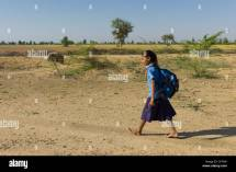 Young Indian Girl In School Uniform Walking Barefoot