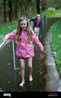 Children Walking Barefoot Shallow Water