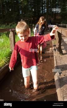 Girls Running Barefoot in Mud