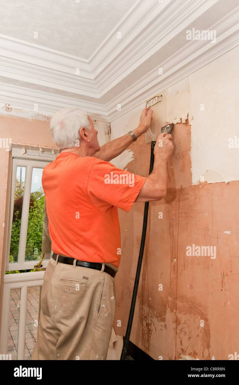 Man Stripping Wallpaper Stock Photos