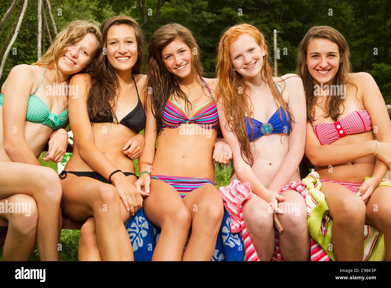 Cute Korean Wallpaper For Cell Phones Five Teenage Girls Sitting On Picnic Table Bikinis Stock