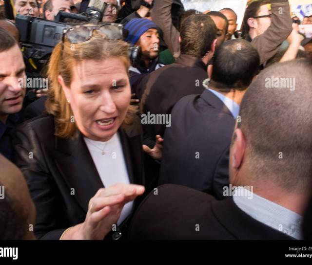 Opposition Leader Ms Tzipi Livni Is Accosted By Protestors Causing Tension Among Her Security Escorts At The Wohl Rose Garden As Thousands Of Ethiopians