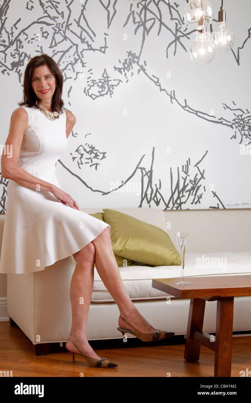 sofa art gallery craigslist sofas mature woman sitting on in stock photo 41271106