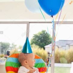 Chair With Balloons Leather Recliner Swivel Baby In High Birthday Cake And Stock Photo