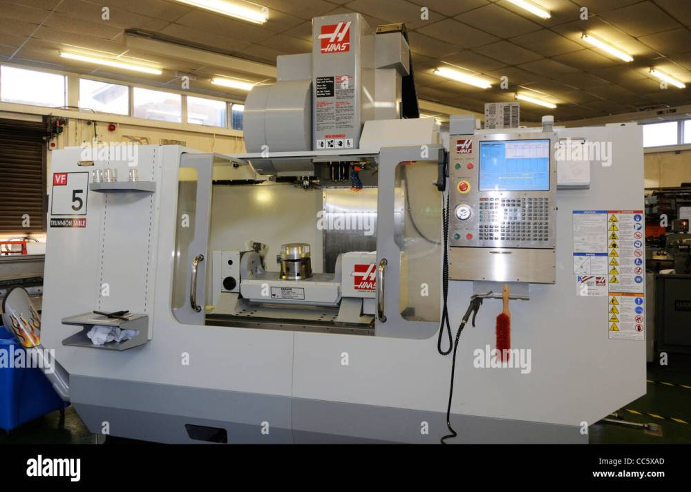 medium resolution of a haas 5 axis milling machine in the workshop area of the uk astronomy centre