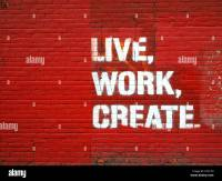 The Words Live, Work, Create Spray Painted Onto Red Brick