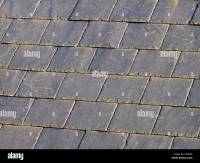 Grey slate roof tiles Stock Photo, Royalty Free Image ...