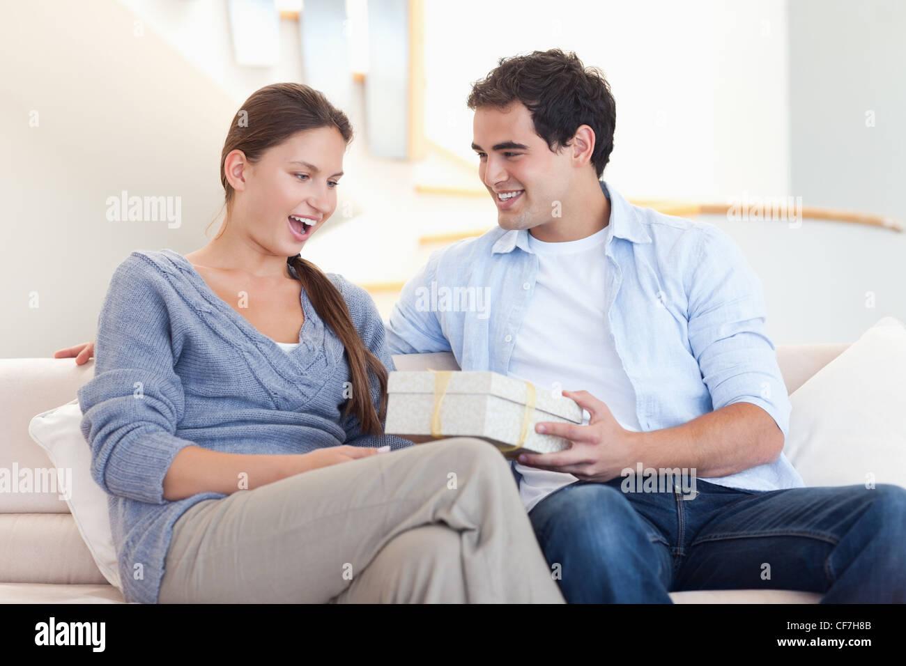 man offering present fiance