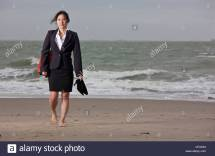 Middle Aged Asian Woman Walking Stock &