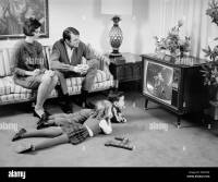 1960s FAMILY OF 4 WATCHING TELEVISION IN LIVING ROOM ...