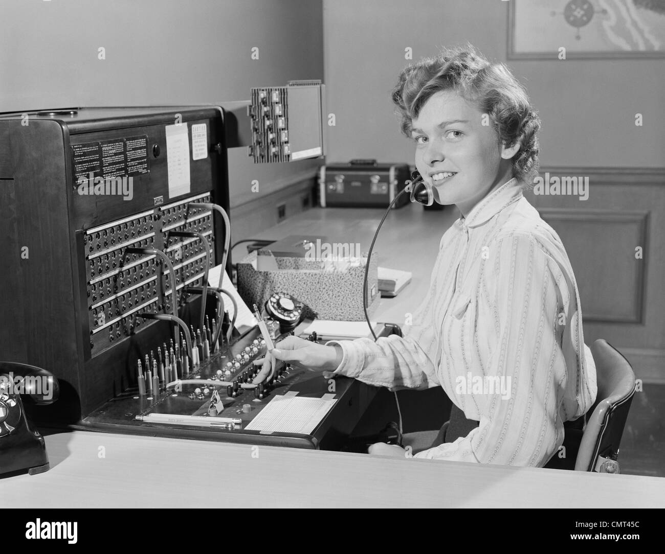 1950s smiling woman office