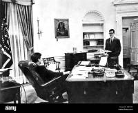 JOHN F KENNEDY US President in the White House Oval Office ...