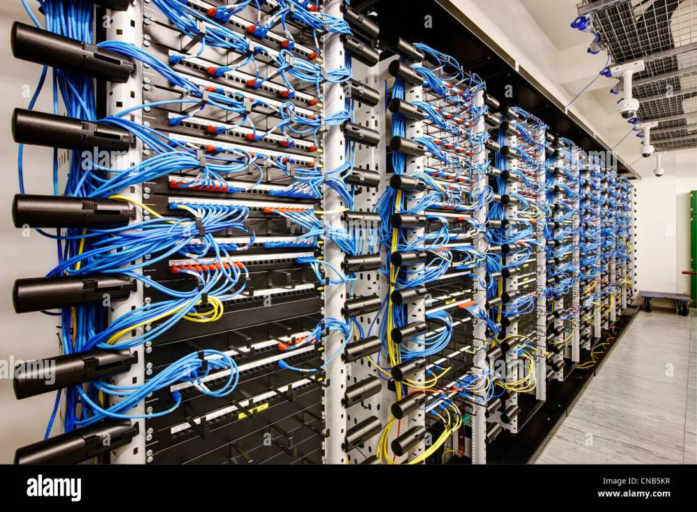 medium resolution of wall of network cabling blue bank computer room stock image