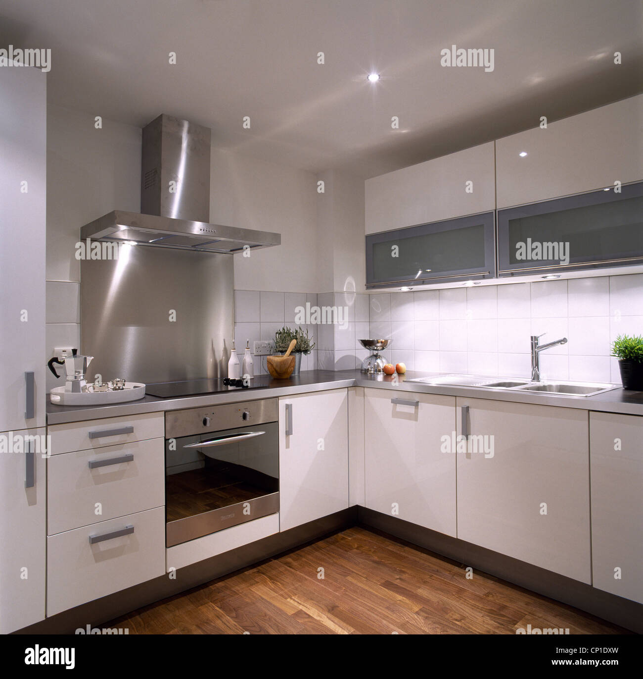 extractor fan kitchen swags a modern white with units stainless steel integral oven and wooden floor