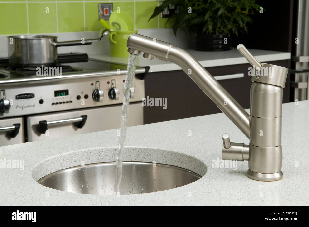 cheap kitchen sink and tap sets booth ideas water running from into round set in worktop