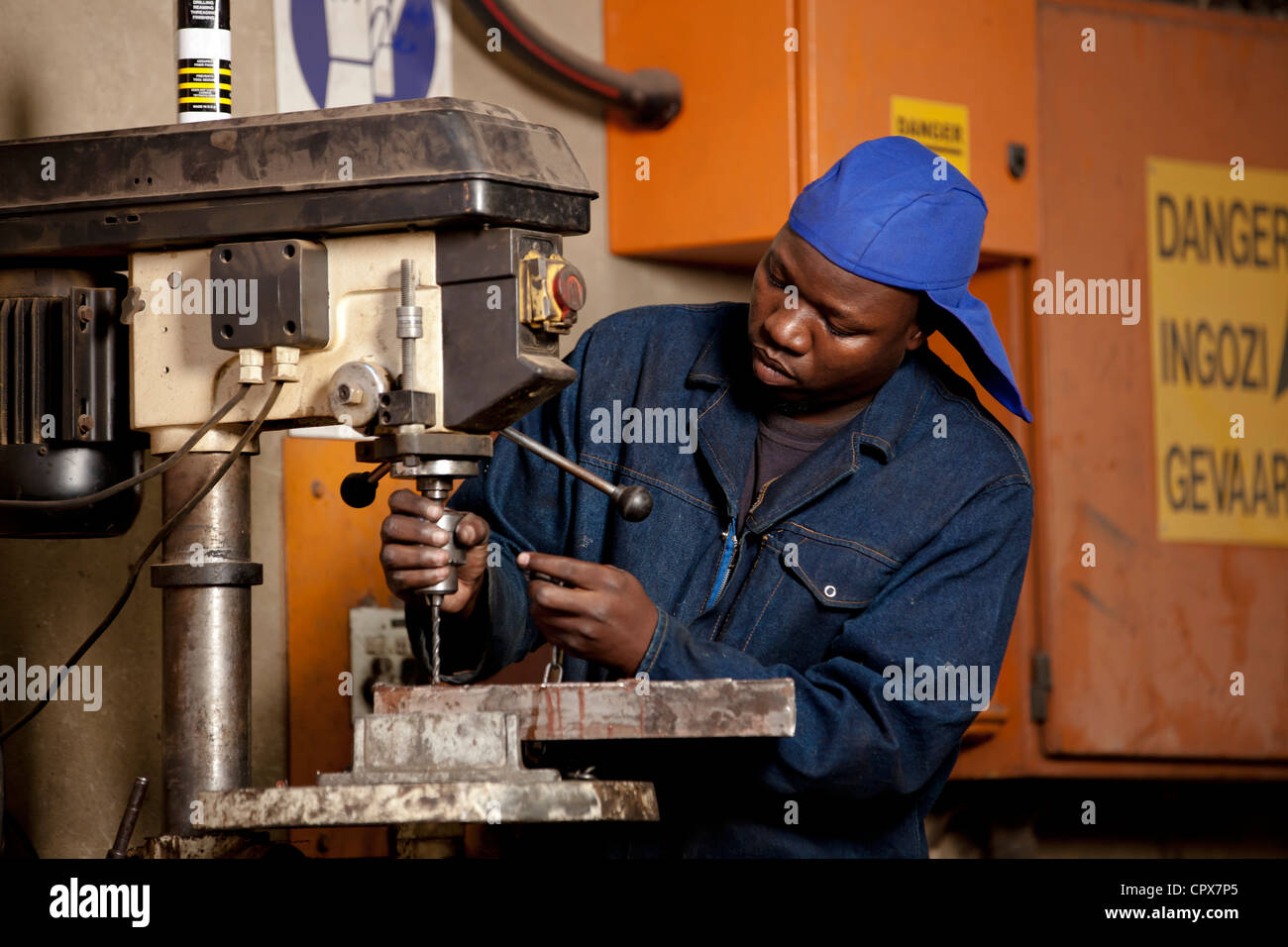 Factory worker operating drill press in magnet factory, Gauteng Stock Photo, Royalty Free Image: 48520029 - Alamy