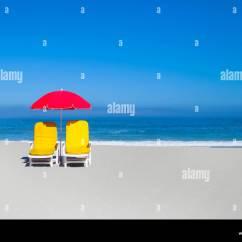 Beach Lawn Chairs Wheelchair Ramp Width Empty And Umbrella On Stock Photo 48594508 Alamy