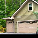 Garage Doors On A Modern House Double Doors With Windows On One Side Stock Photo Alamy