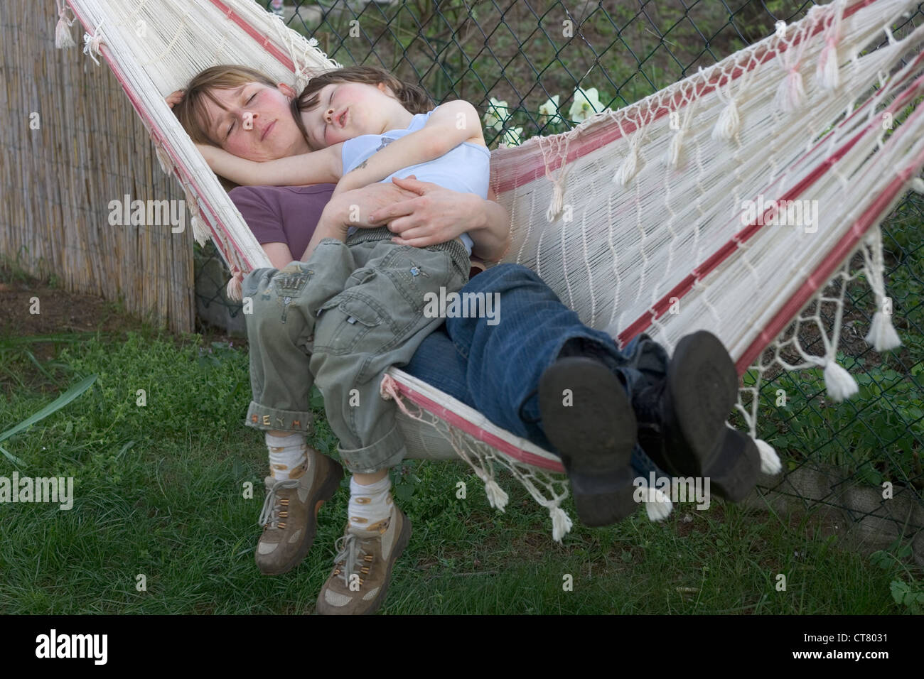 Mother And Child Sleeping In A Hammock Stock Photo