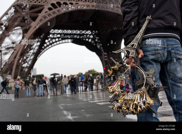 Man Illegally Selling Eiffel Tower Souvenirs In Front Of