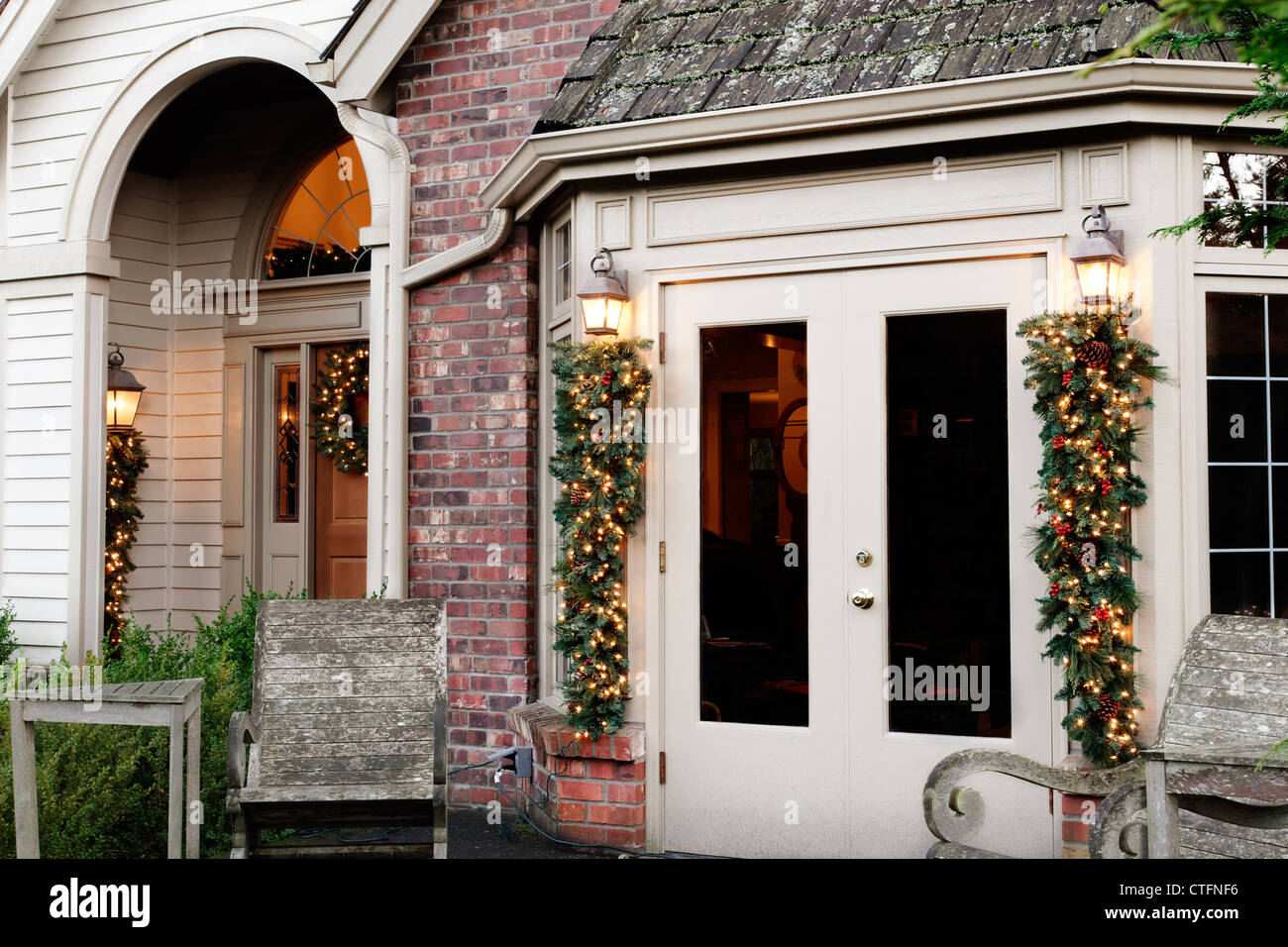 Outdoor Christmas decorations on french doors & porch