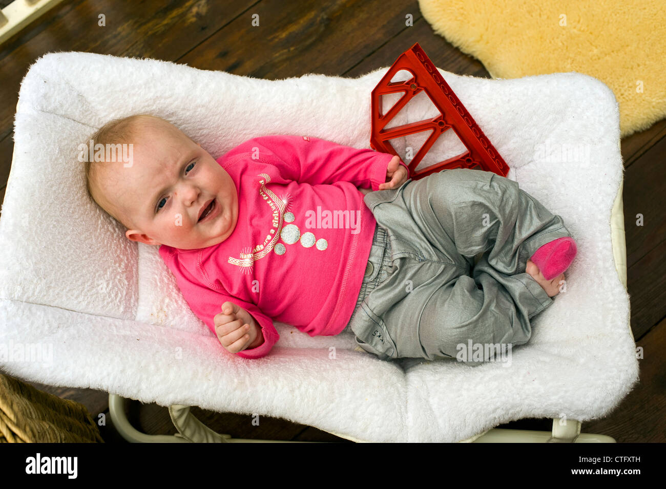 baby girl chair panton review enjoying herself in her stock photo
