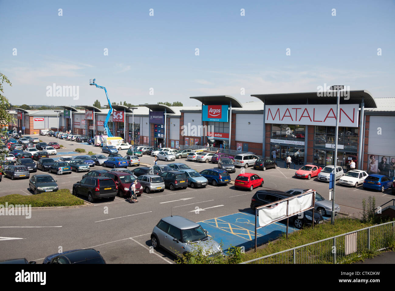 retail out of town park with various stores and car park