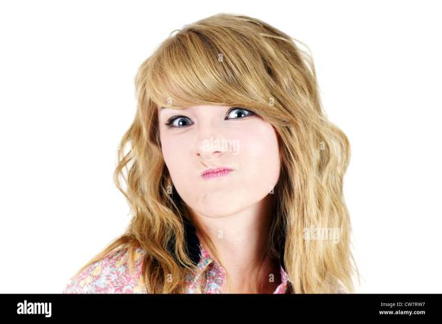 Cute Young Blond Teenager Girl Making A Funny Unhappy Or Upset Face Studio Shot On White