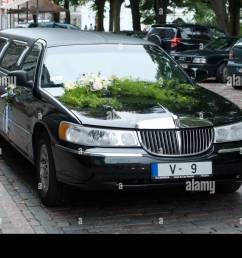 wedding limo lincoln town car black stock image [ 1300 x 960 Pixel ]
