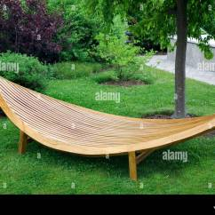 Wooden Garden Chairs Uk Cover Wholesale Furniture Stock Photos Sleek Modern Made Of Wood And Varnished Image