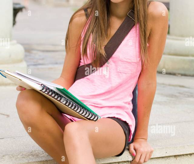 Portrait Of A Beautiful Tanned Young Student Girl Outdoors
