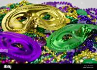 Mardi Gras masquerade mask on a background of colorful ...