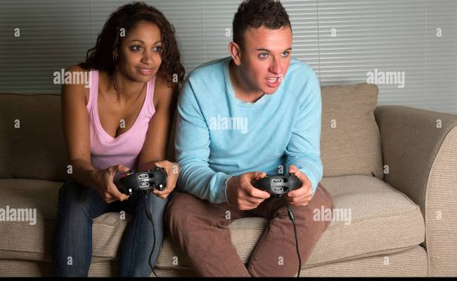 Young Couple Playing Xbox Computer Games Stock Photo