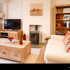 Living Room With Log Burner Navy Blue Velvet Sofa Contemporary Neutral Colors Wood And Wooden Floor Photographers Own Artwork On Wall Bookcase