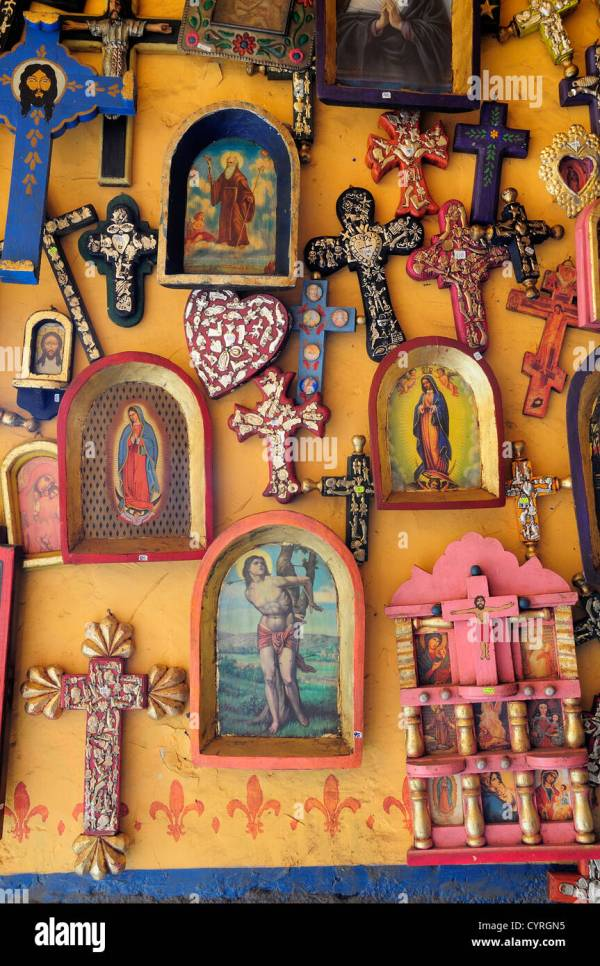Religious Kitsch Art Displayed Yellow Painted Wall