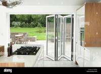 Kitchen with open patio doors Stock Photo, Royalty Free ...