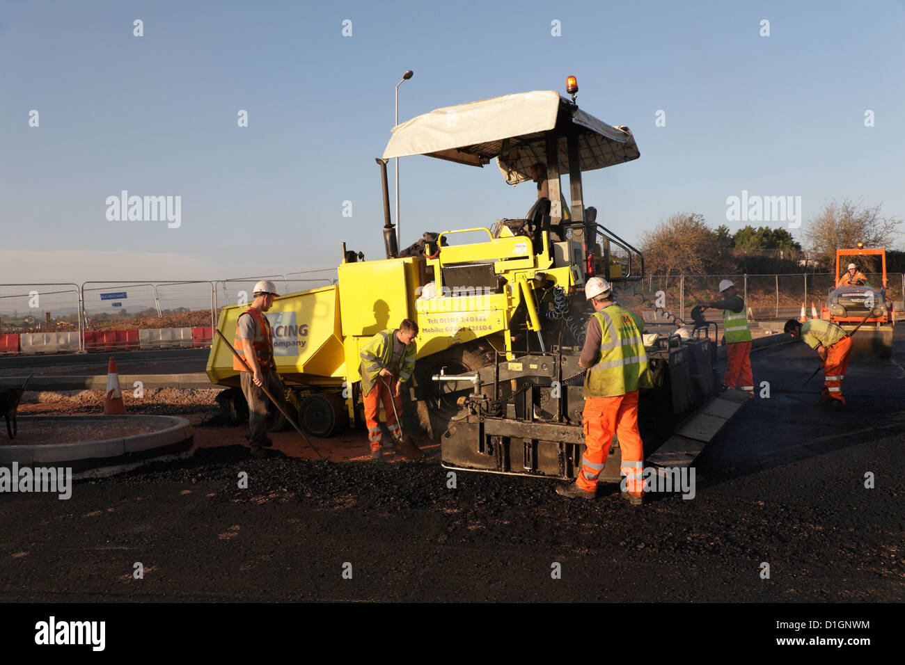 A Civil Engineering contractor highway maintenance gang laying Stock Photo Royalty Free Image